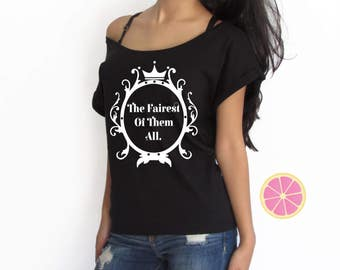Disney tshirt the fairest of them all tshirt. Disney mirror mirror on the wall off shoulder T-shirt. Boat neck t-shirt made by Pink Leomonad