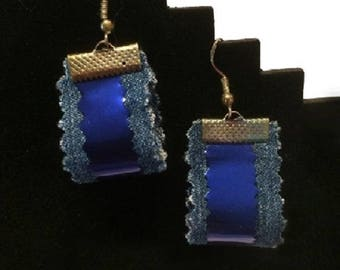 Earrings made of recycled blue jeans and bobbin