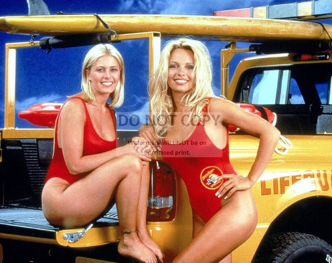 """Pamela Anderson and Nicole Eggert in the TV show """"Baywatch"""" - 8X10 Publicity Photo (CC978)"""