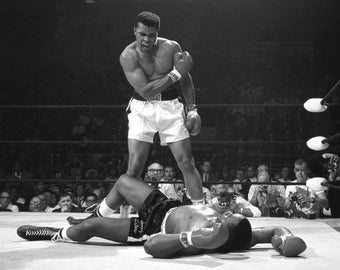 Muhammad Ali Stands Over Sonny Liston in Lewiston Maine 1965 - 8X10 or 11X14 Photo (ZY-152)