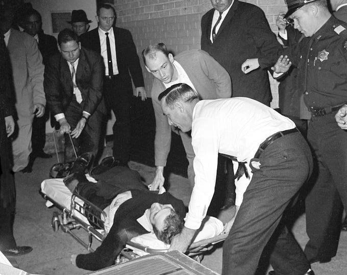 Lee Harvey Oswald is Placed on a Stretcher After Being Shot by Jack Ruby in the Dallas Police Headquarters - 8X10 Photo (AA-931)