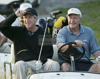 George W. Bush Golfing with Father George H.W. Bush - 5X7, 8X10 or 11X14 Photo (WW011)