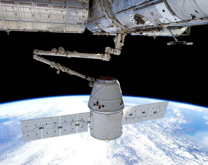 SpaceX Dragon Capsule Captured by the International Space Station - 8X10 or 11X14 NASA Photo (AB-686)