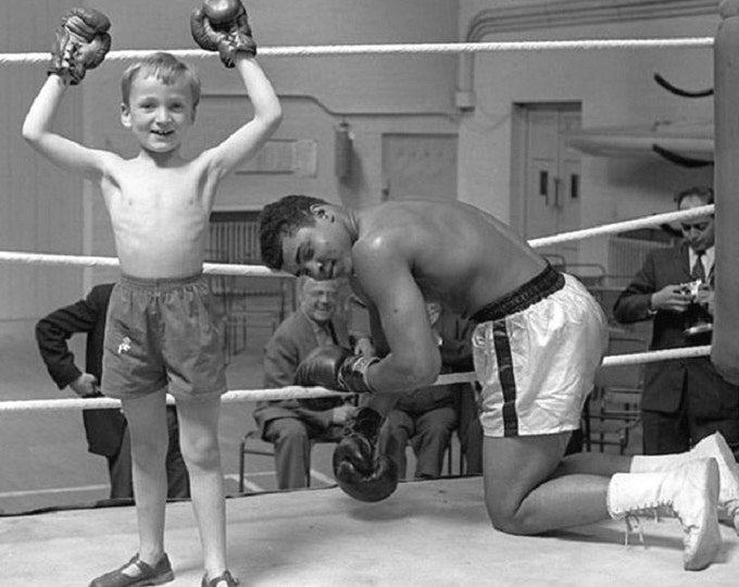"""Muhammad Ali """"Goes Down"""" in the Ring Thanks to a Kid - 8X10 Publicity Photo (ZY-157)"""