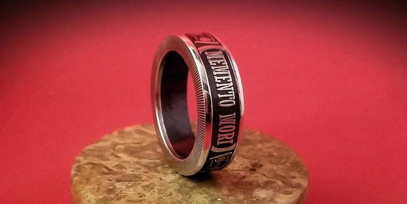 Silver Memento Mori ring and pendant. image 0