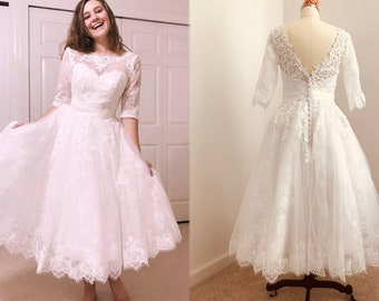 47f33a65354 Vintage See Through Illusion Neck Open V Back Buttons Lace Bridal Gown  Outdoor Reception Tulle Tea Length Short Wedding Dress 3 4 Sleeves