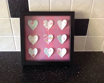 Heart shapes in wooden frame