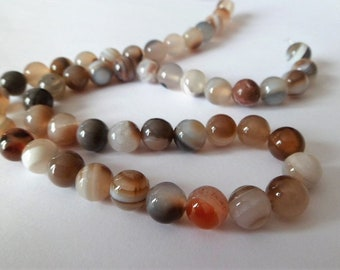 Brown and gray round bead in Botswana Agate