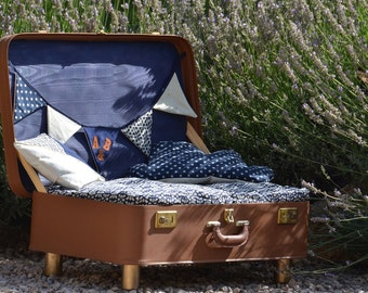 Dog bed in a vintage suitcase