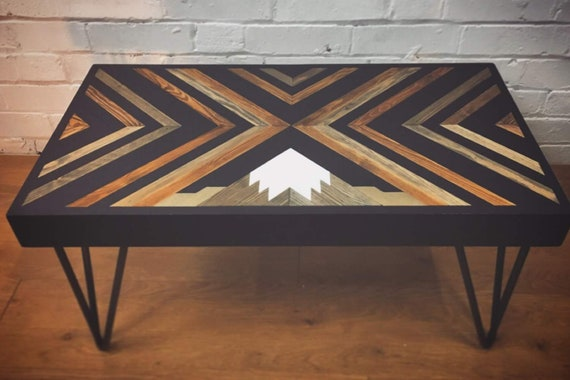 Coffee table with mountain and geometric pattern made from reclaimed wood and off cuts