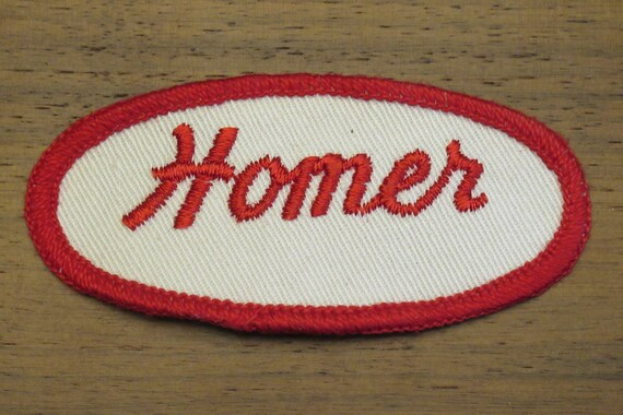 faded work uniform patch with Hugh in red stitching Hugh white