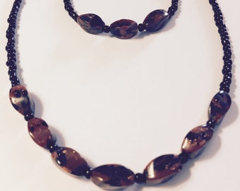 Brown and black matching necklace and bracelet set
