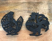 Black cast iron trivet hot plates. Cockerel rooster and hen designs. approx. 15cm wide