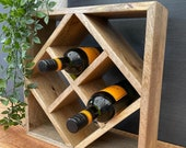 Mantis solid natural Mango fruit wood wine rack counter or wall wine storage. Holds 4 standard wine and 4 champagne bottles