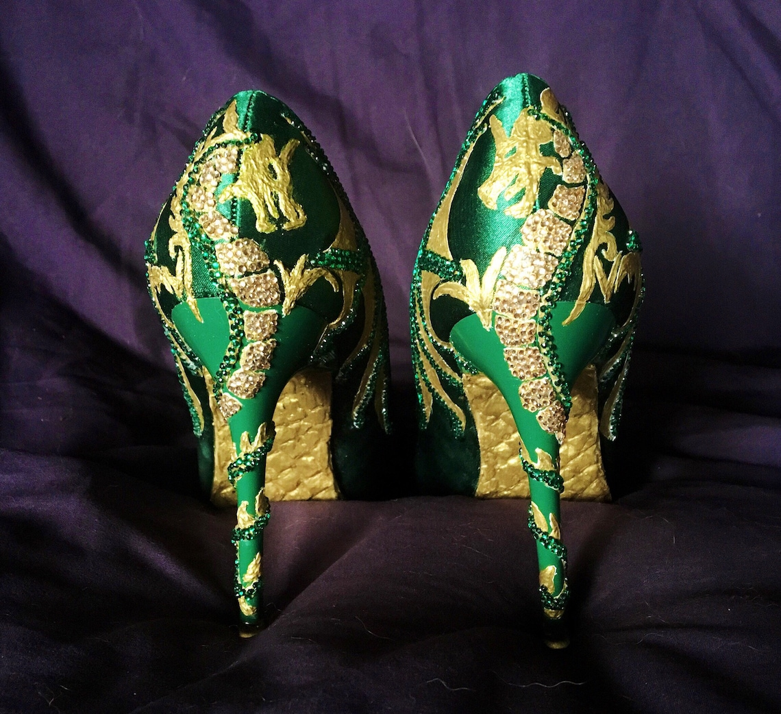 Tacones de dragón de brillo verde