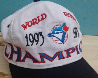 40f450970dc Vintage 90 s 1993 Toronto Blue Jays World Series Champions Made by Logo 7  Cream White Baseball Cap Hat Snapback
