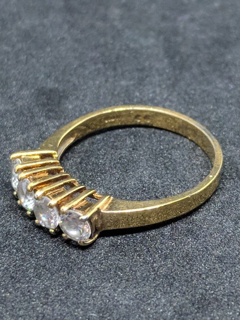 Sweet Vintage Gold tone Ring with Four Clear Rhinestones