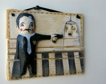gunman with gold heart - hanging sculpture