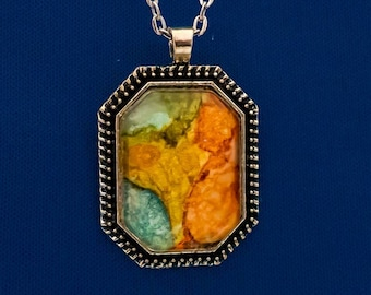 Charming hand painted octagon pendant necklace in bright orange.