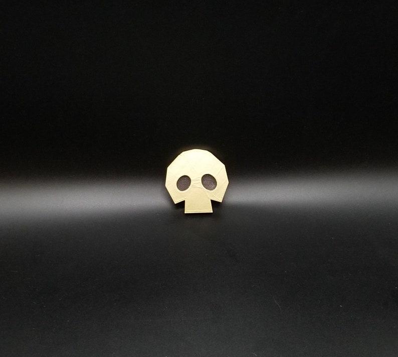 Legend of Zelda Ocarina of Time Golden Skulltula Skull Magnet image 0