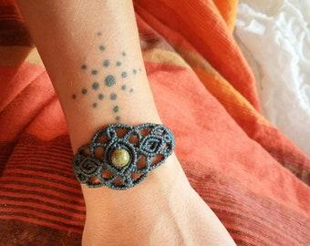 Dark blue Macrame bracelet with green stone