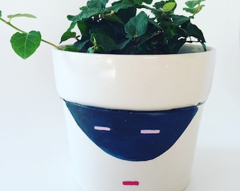 """Masked """"crackpot"""" upcycled planter"""