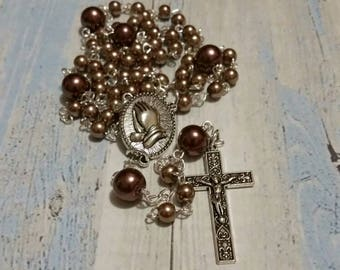 Five decade Catholic rosary, silver toned, brown glass pearls, praying hands center and decorative crucifix, religious