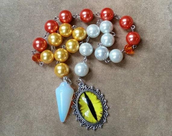 Samhain prayer beads, pagan prayer beads, Samhain witches prayer beads, stainless steel, glass pearls, Opalite pendulum, yellow dragon eye