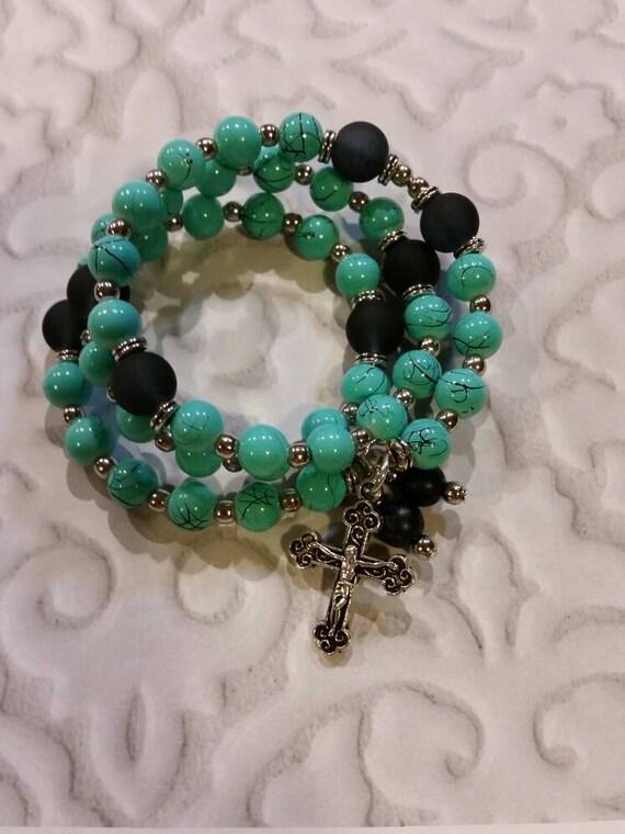 Lutheran rosary bracelet, Lutheran prayer bracelet, memory wire bracelet, wrap bracelet, blue and black glass beads, budded crucifix, silver