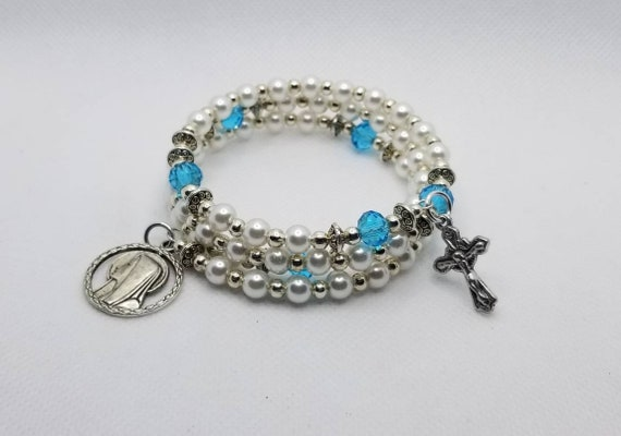 Bracelet, Catholic five decade memory wire bracelet, silver tone, off white glass pearls, blue glass rondelles, religious medal, crucifix