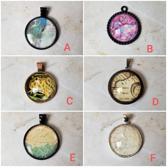Peach blossom, photo behind glass, frog pendant, map pendants, glass and silicone cabochons, assorted photo jewelry, old maps