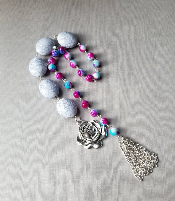 Baha'i prayer beads, Tye-dyed and ivory 19 and 5 prayer beads in silver tone with large rose charm and handmade chain tassel