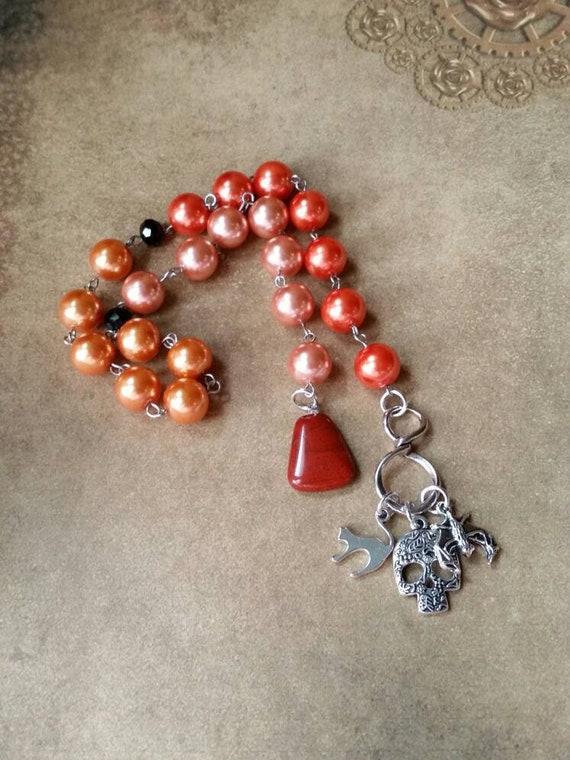 Samhain prayer beads, pagan prayer beads, Samhain witches prayer beads, stainless steel, glass pearls, Red Jasper, three spooky charms