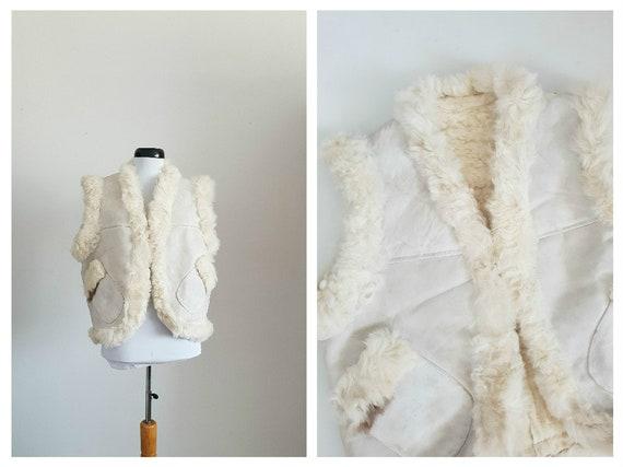 Vintage 1970s curly lamb fur vest   70s hippie fol