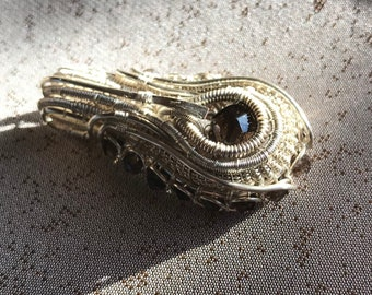 A wire wrapped complex pendant