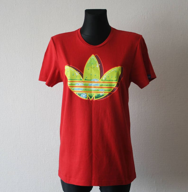 5321d059a Vintage ADIDAS red T shirt Bright electric green trefoil on | Etsy