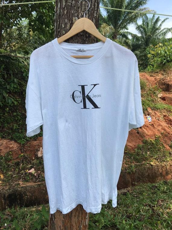 bc535ed5b5d9 Vintage Calvin Klein T Shirt Vtg Ck Shirt Made in USA Big Logo | Etsy