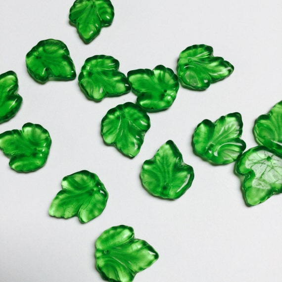 #722 - 24 Pieces center-drilled Transparent Pressed Glass Leaves in Green