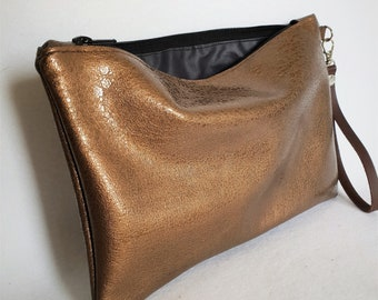 gold leather clutch with its strap
