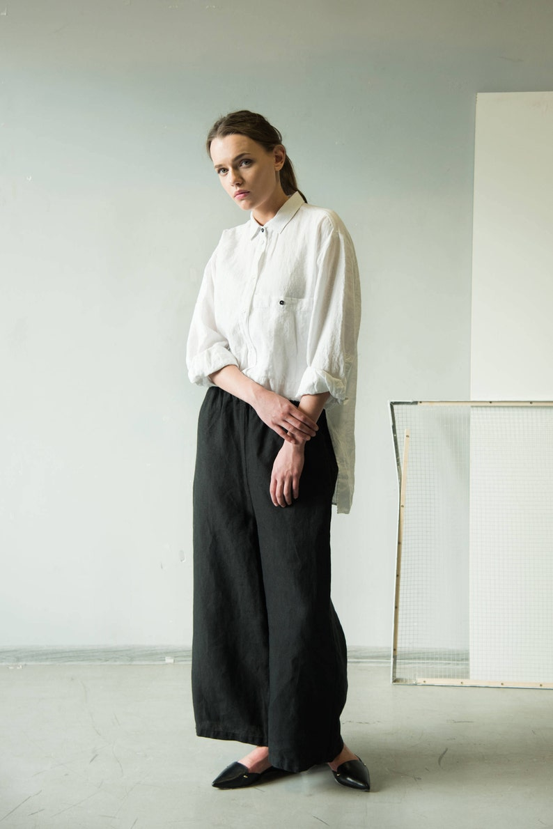 9542642f353 Asymmetrical white linen shirt with long sleeves and classic