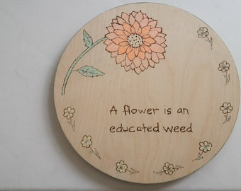 flower is an educated weed garden plaque