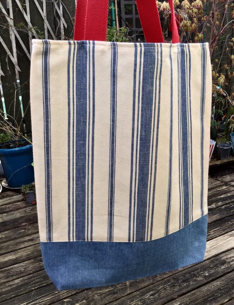 Tote bag Bel Air stripe in cobalt by Schumacher with a light blue denim bottom. Cotton