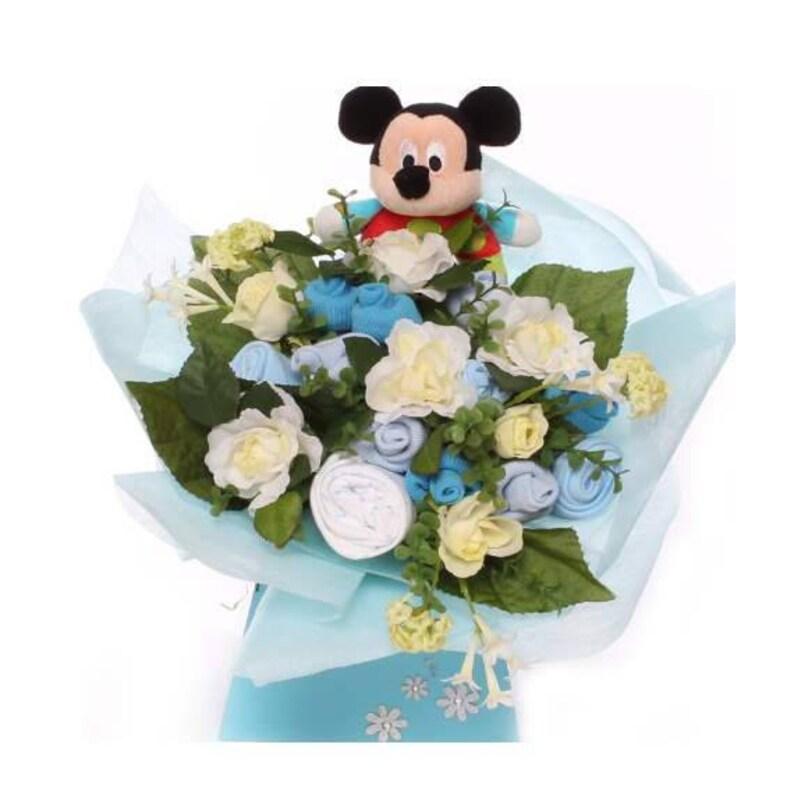 f479912e5 Bouquet de bebé de regalo Disney baby con suave traqueteo de