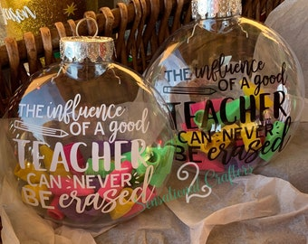 """The influence of a good teacher can never be erased 4"""" Shatter Proof Plastic Glittered Ornament."""