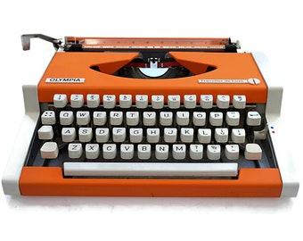Typewriter in Retro Orange, Vintage Orange Typewriter. Olympia Traveller De Luxe Mid-century Modern Portable Typewriter in working condition
