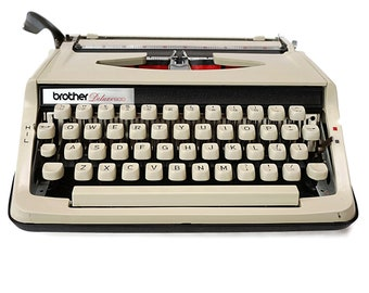Retro Typewriter, Vintage Brother Deluxe 800. A Portable, Manual Typewriter in good working condition.