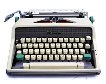 Olympia Typewriter, Solid working typewriter, Classic Vintage typewriter from 1960s. Vintage Office typewriter Olympia SM7