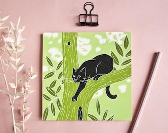 Postcard cat on a tree
