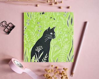 Postcard cat on the meadow