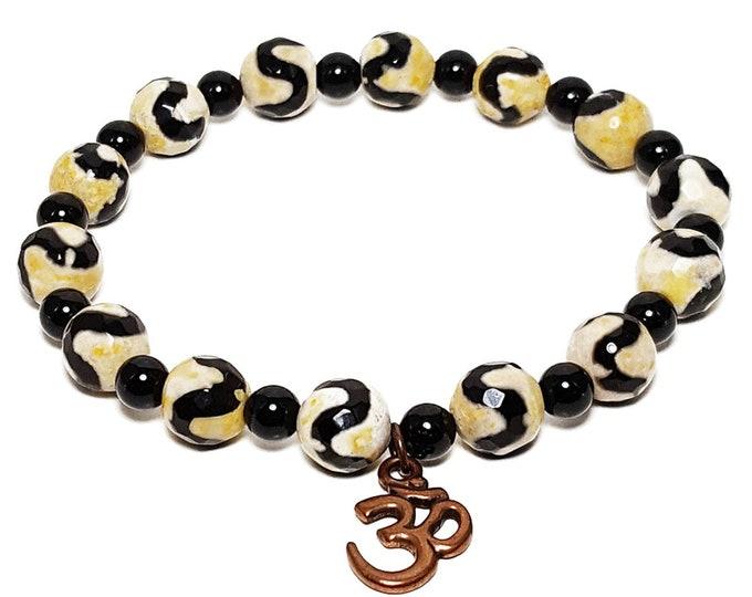Strength + Healing Bracelet: Tibetan Agate & Black Onyx Gemstone Beads + Bronze Ohm Charm.